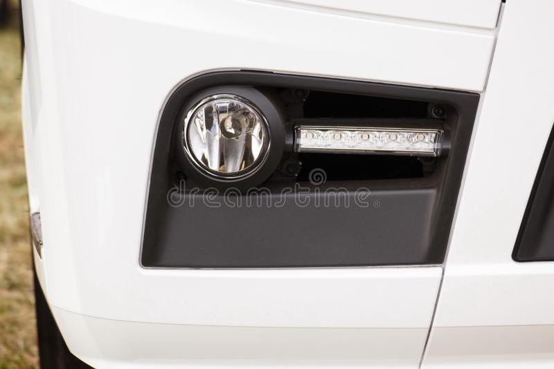 Front light, LED light of cargo truck or long vehicle, safety during travel. Front light, LED light of cargo truck, tractor or other long vehicle, detail and royalty free stock photo