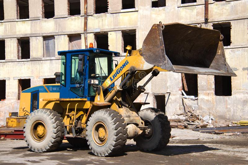 Front loader LiuGong CLG 842 close-up on the reconstruction of a residential building. SAINT-PETERSBURG, RUSSIA - MAY 04, 2017: Front loader LiuGong CLG 842 royalty free stock image