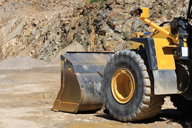 Front loaders in quarry stock photography