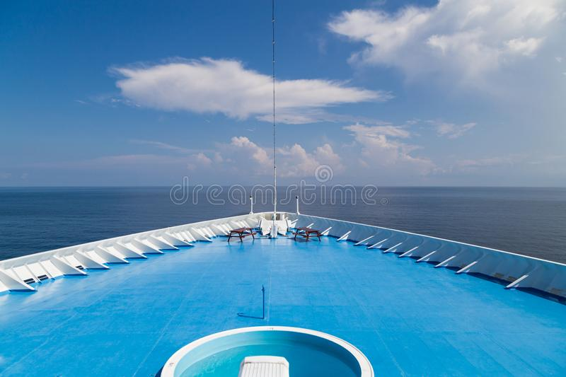 Front of cruise ship deck over looking ocean horizon. Front of luxurious cruise ship deck over looking ocean horizon royalty free stock photography