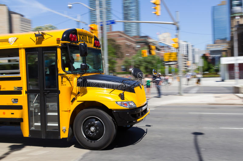 Front of a Moving School Bus. TORONTO, CANADA - JUNE 1ST, 2014: The front of a school bus moving at speed in Toronto stock photography