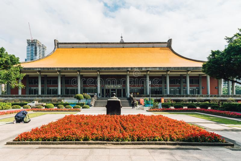 Front of National Dr. Sun Yat-Sen Memorial Hall. Yellow rooftop and sculpture in rectangle red flowers area. Front of National Dr. Sun Yat-Sen Memorial Hall stock image