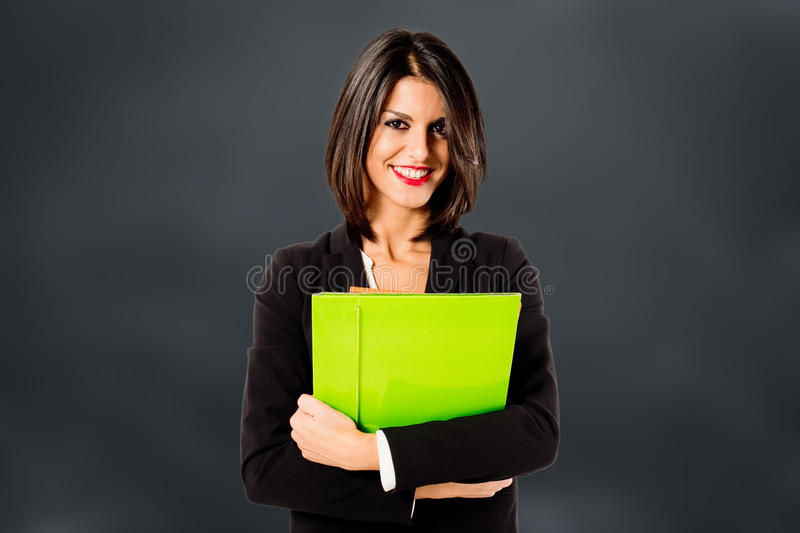 Front office. Young executive woman stock image