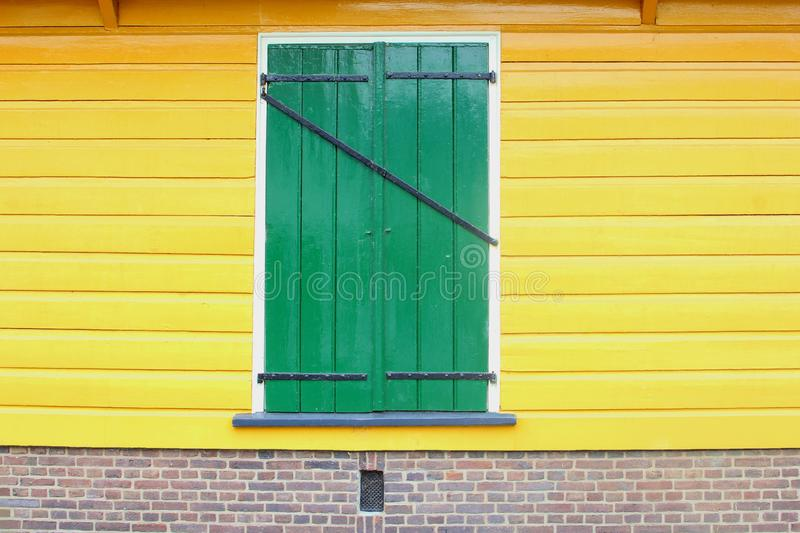 Front old Dutch house shutter window yellow walls, Netherlands stock images