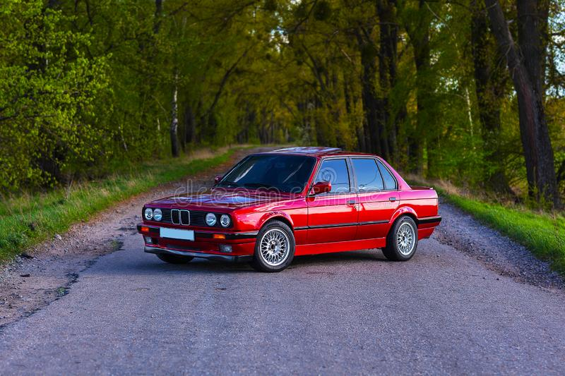 The front of the old, red, German car that stands in the forest stock image