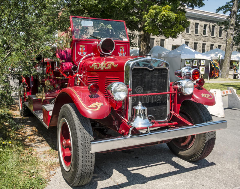Front of a Old vintage fire truck. Front of aOld vintage fire truck on a nice sunny day stock photo