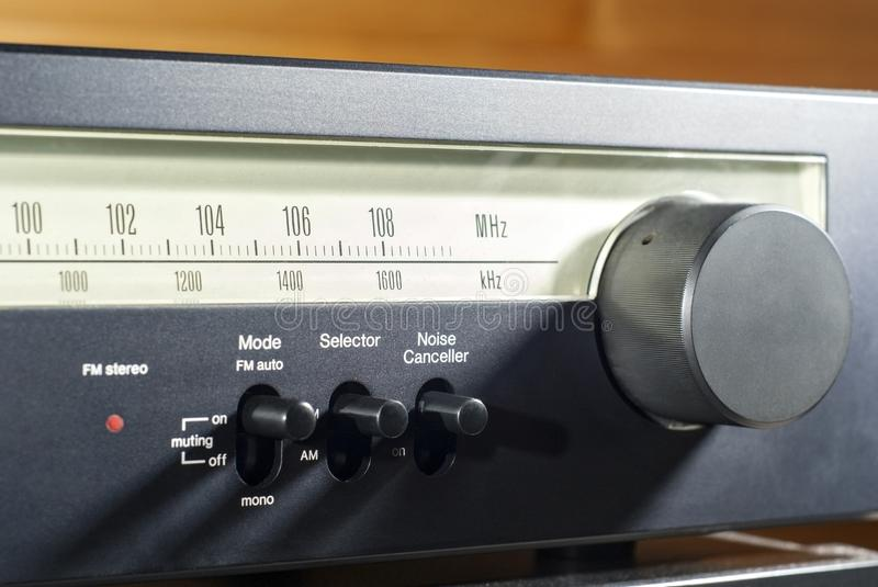 Front panel of a radio with a frequency scale stock image