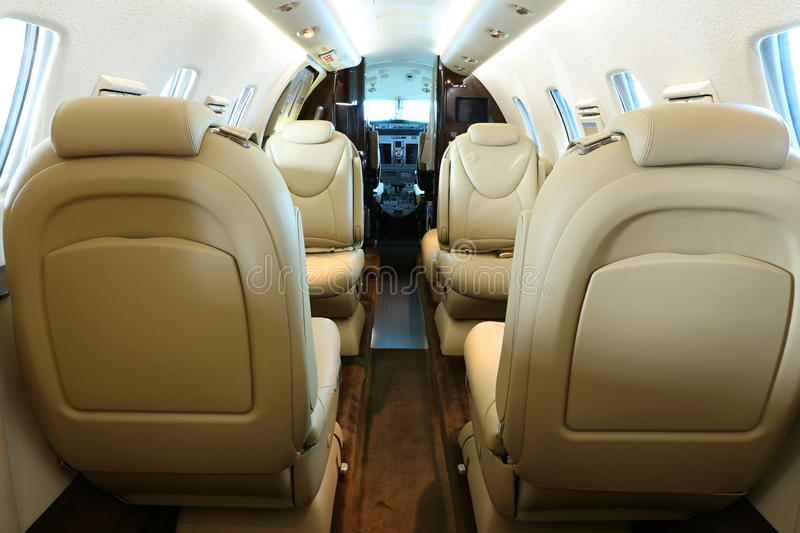 Front part of business jet cabin stock image