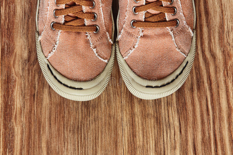 Front part of Gym shoes on grunge wooden background.Top view. royalty free stock image