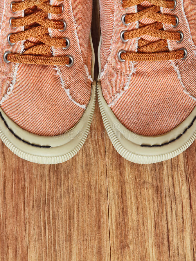 Front part of Gym shoes on wooden background. royalty free stock photos