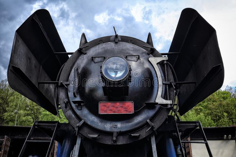 Front part of old steam engine boiler stock photography