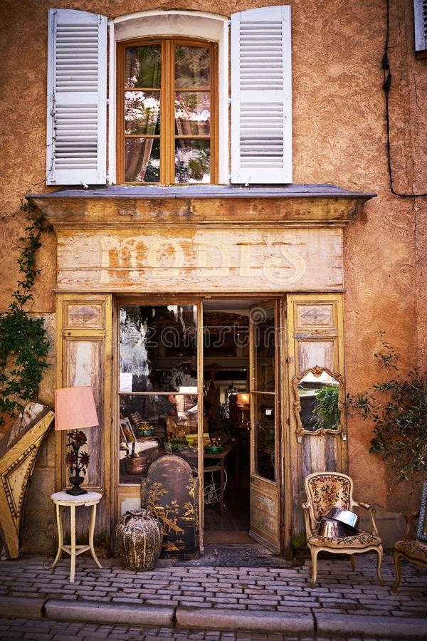 The front of a picturesque Provencal bric-a-brac shop. Facade of a picturesque brocante shop in the Provence, in the South of France royalty free stock image