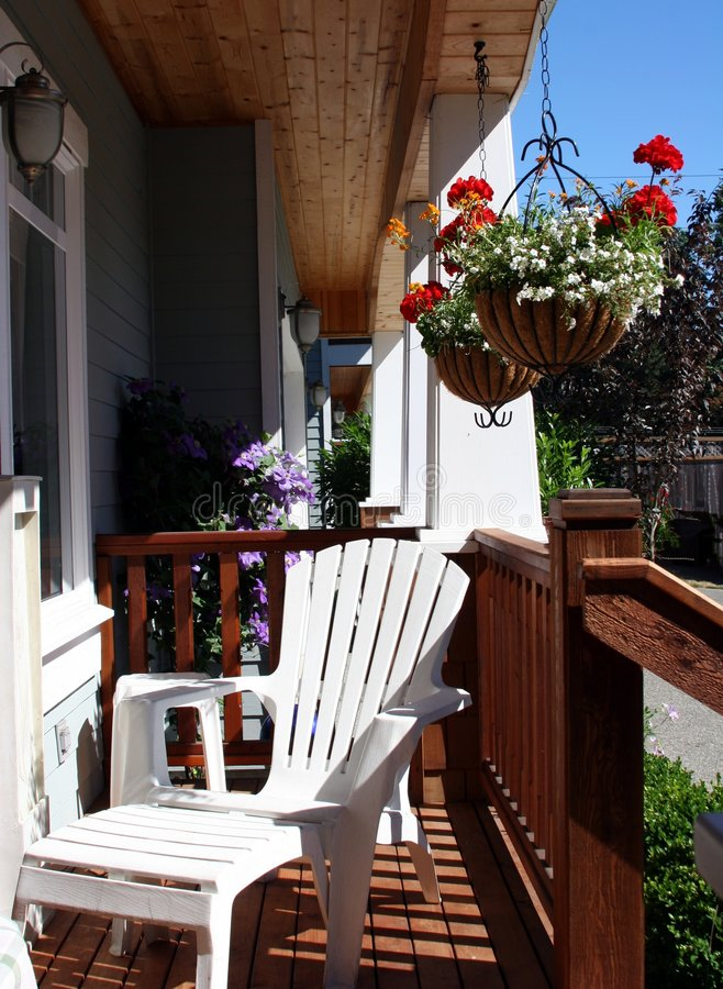 Front Porch. An adrionack chair on a front porch royalty free stock image