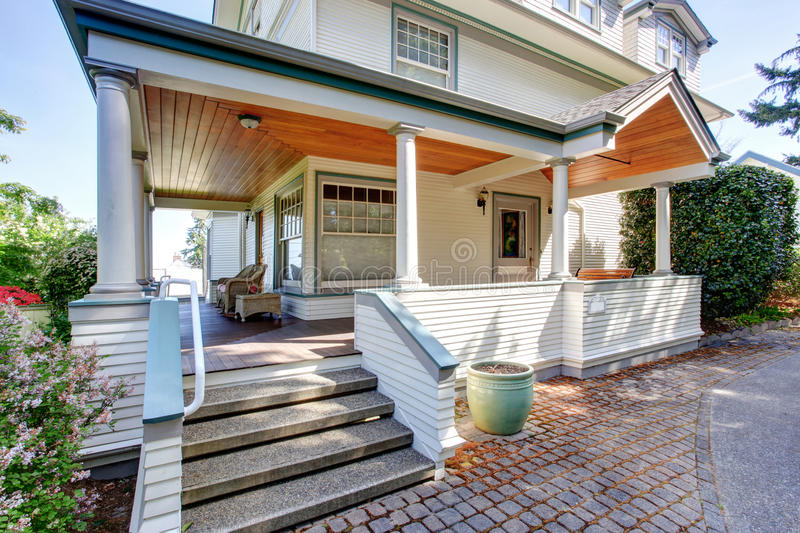 Front porch with chairs and columns of craftsman home for How to build craftsman porch columns