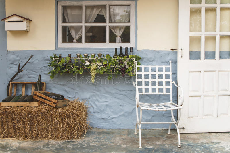 Front porch of a house. With chairs and windows stock photo