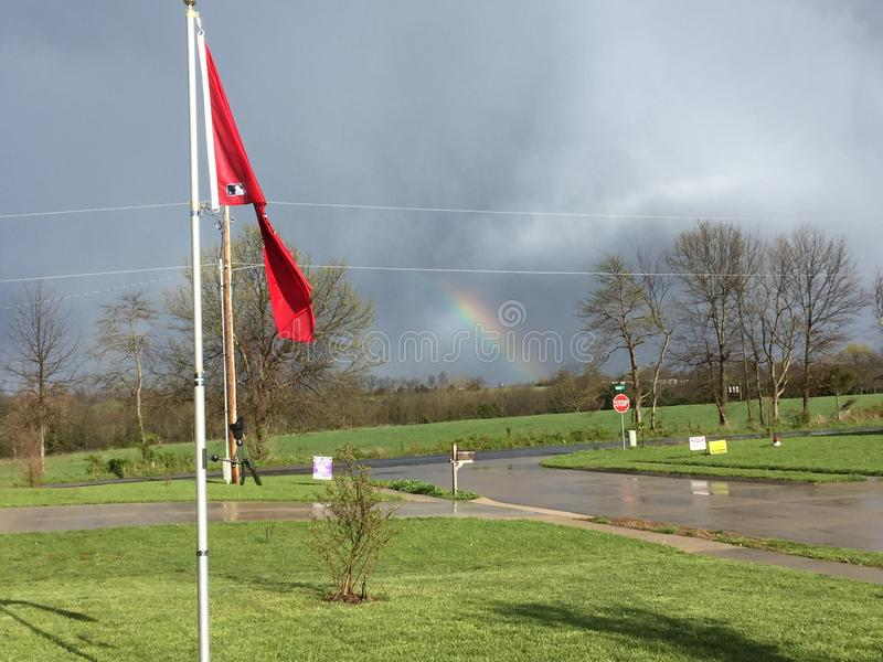 Front porch view of rainbow stock photo