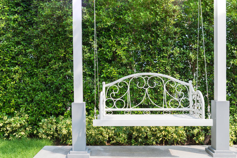 Front porch with a white porch swing at garden in house. Front porch with a white porch swing at garden in house stock photography