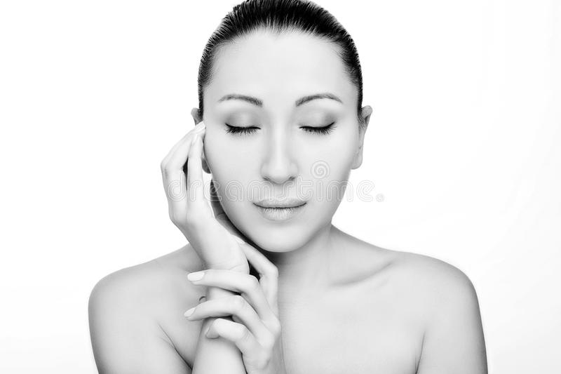 Front portrait of beautiful face with beautiful closed eyes. Monochrome stock photography