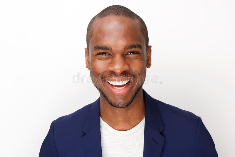 Front portrait of handsome black man smiling against isolated white background royalty free stock photo