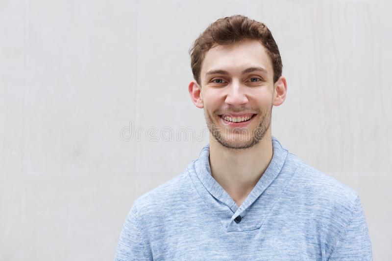 Front portrait of handsome young man smiling and looking at camera royalty free stock photos