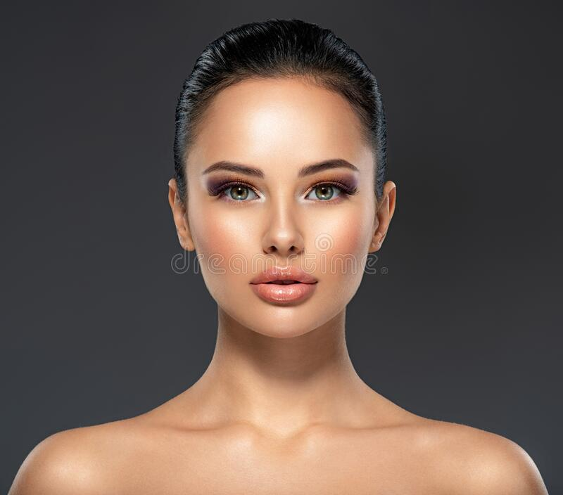 Front portrait of the woman with beauty face - isolated. Beauty face of the young beautiful girl with a healthy skin.  Skin care stock photo