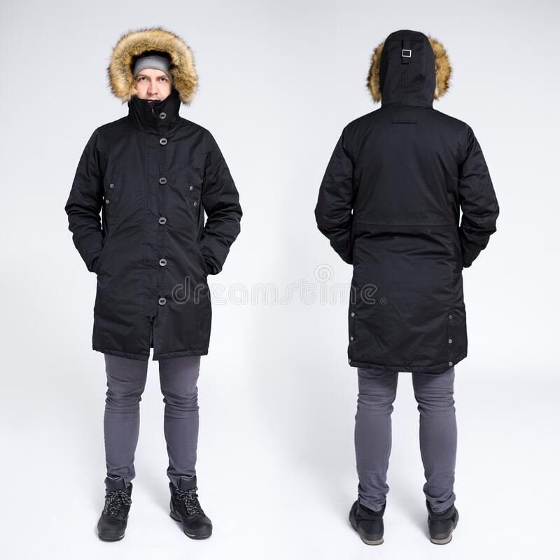 Front and rear view of young handsome man in warm winter jacket over gray background stock photography