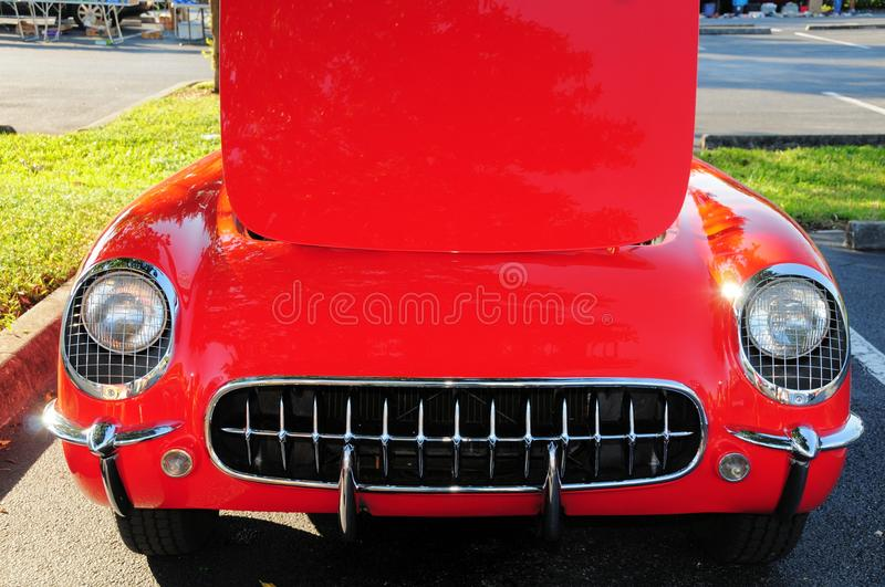 Front of red sports car hood up