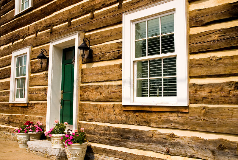 Front of restored log house stock image