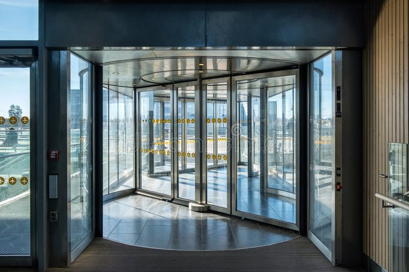 Front revolving transparent automatic rotate door. In the airport stock images