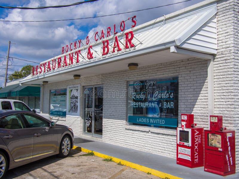 Front of Rocky & Carlo`s Italian Restaurant and Bar in Chalmette, St. Bernard Parish, Louisiana. Front of Rocky & Carlo`s Neighborhood Restaurant and Bar Showing stock photos