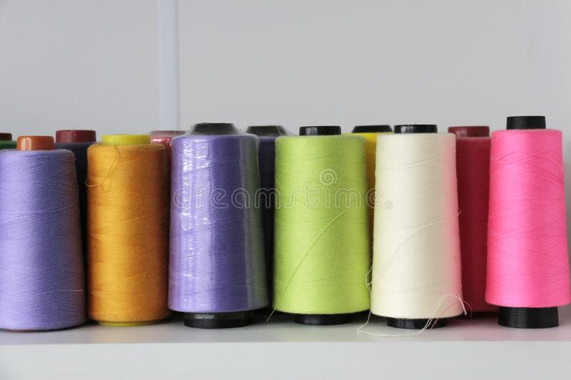 In a front row of thread in spool royalty free stock image
