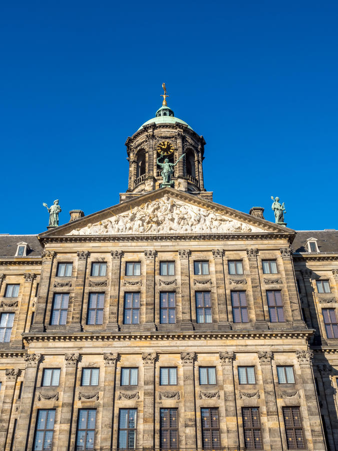 Front of Royal palace in Amsterdam. The front of Royal Palace at the Dam Square, Amsterdam, built as city hall during the Dutch Golden Age in the seventeenth royalty free stock photo