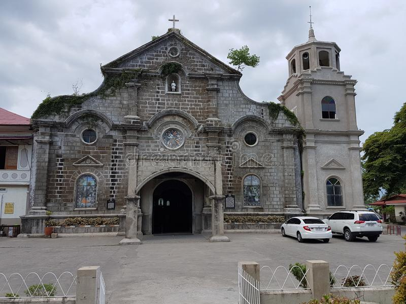 Front of San Juan church in Batangas city, Philippines. NBuilt in the 1800`s was completely destroyed by a flood shortly after then rebuilt using rocks royalty free stock photos