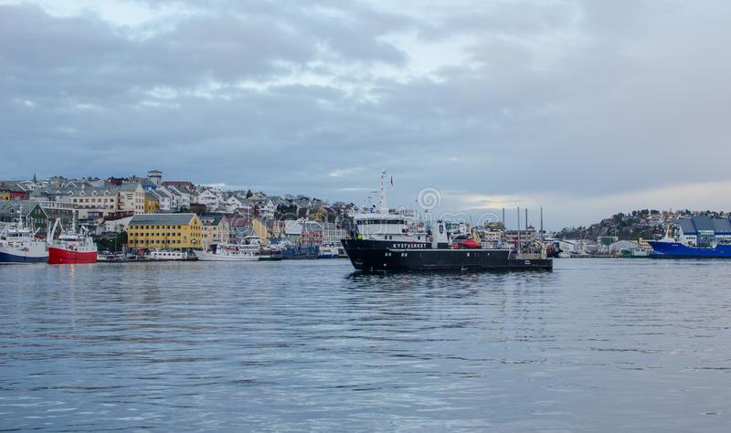 Boat Kystverket: named `Ona` in front on the city town Kristiansund royalty free stock photos