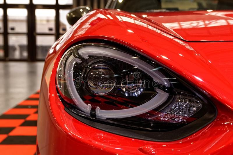 Detailed headlight of red sportcar royalty free stock photos