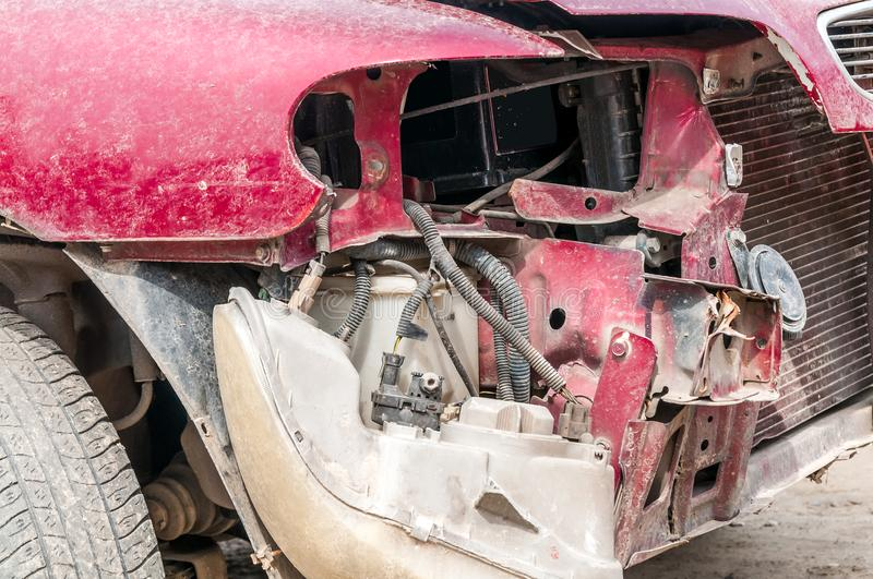 Front side of broken and damaged car wreck in crash accident with fatal outcome in collision close up.  stock images