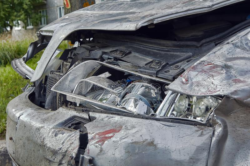 Front side of car after accident on a city road. Rezkene,Latvia, August 26, 2019: car after accident on a road because of frontal collision, transportation royalty free stock photo