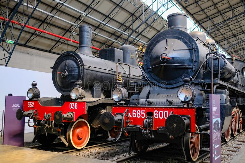 Front side of two ancient steam trains. Two ancient steam trains the railway station in the museum `museo della scienza e della tecnica` at Milan royalty free stock photography
