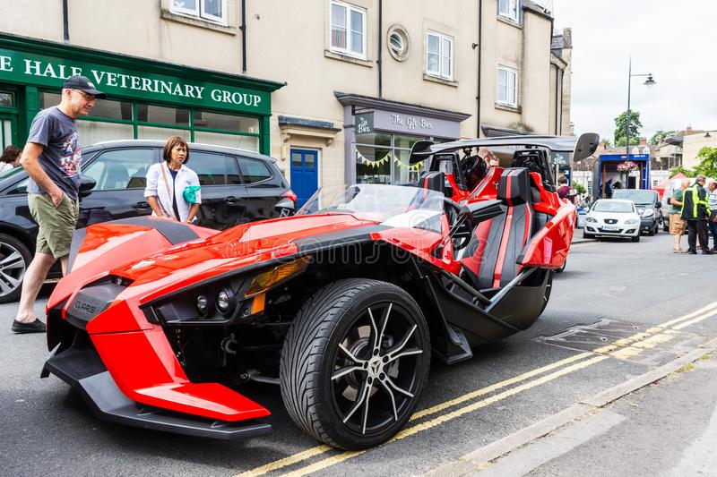 Calne, Wiltshire, UK, July 27, 2019. Red Polaris slingshot trike/tricycle royalty free stock photography