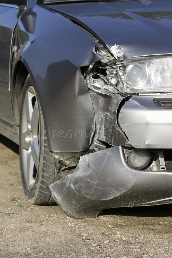 Front of silver car get damaged by crash stock image