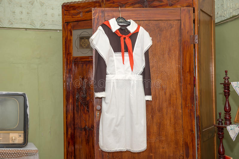 The front Soviet school uniform with a pioneering tie hanging on. The door of the old cabinet stock images