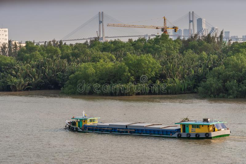 Front steering barge on Song Sai Gon river, Ho Chi Minh City, Vietnam stock images