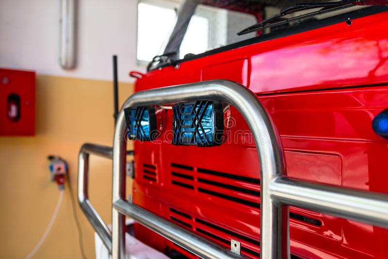 The front of the truck of an old Polish fire truck with visible blue light signals and chromed grill. stock image