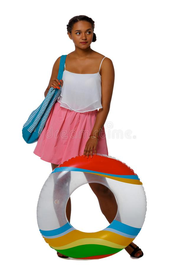 Front view of an African-American with an inflatable circle royalty free stock photography