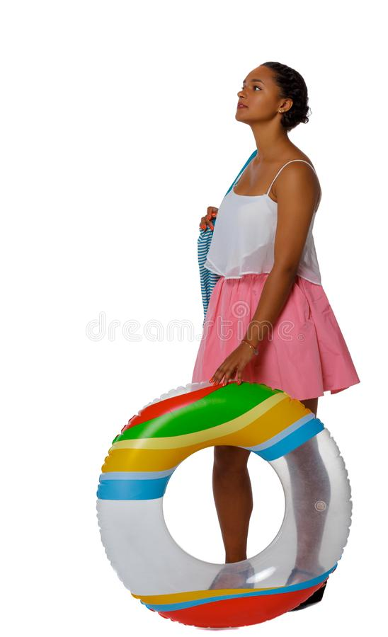 Front view of an African-American with an inflatable circle stock image