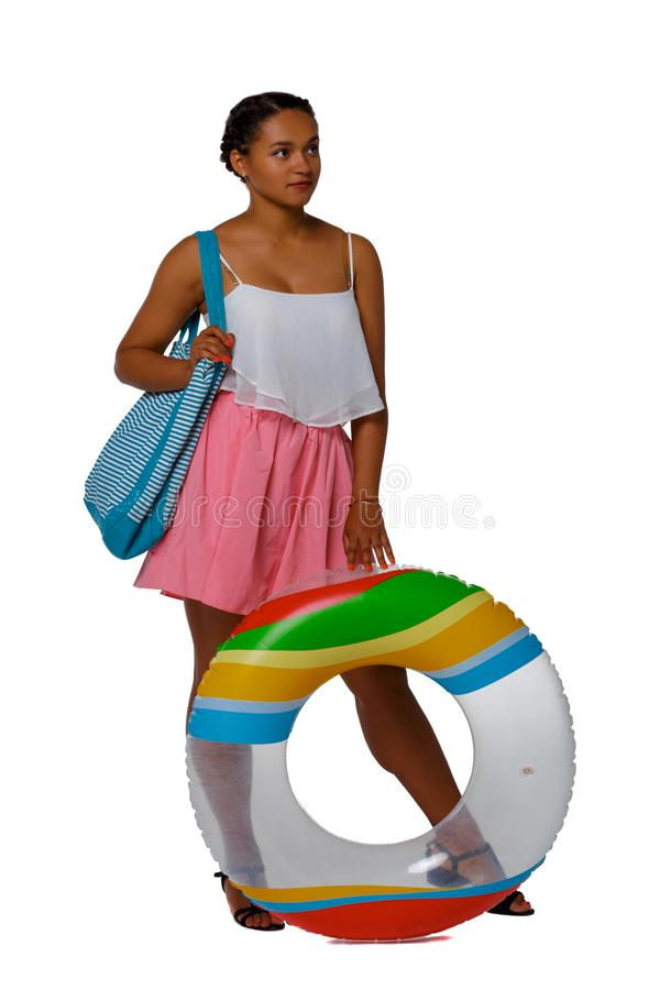Front view of an African-American with an inflatable circle stock photography