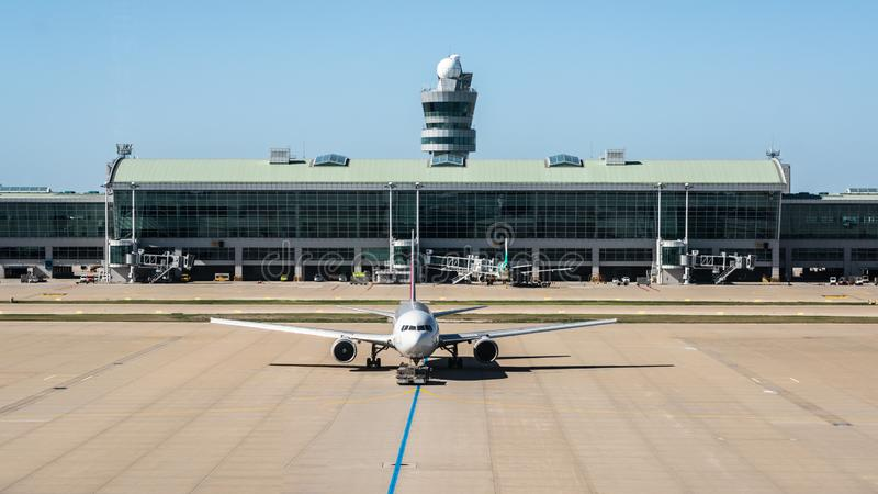 Front view of an aircraft at Incheon international Airport with terminal and control tower view in Seoul South Korea royalty free stock photography