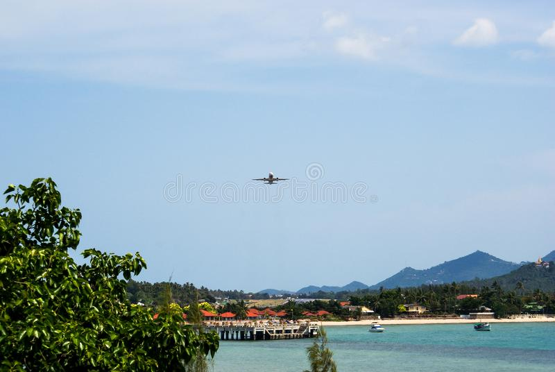 Front view of the aircraft taking off from the Samui airport, located on the beach.  royalty free stock images