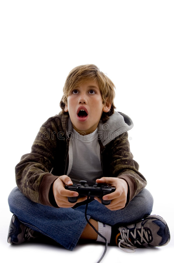 Front View Of Amazed Kid Playing Computer Game Royalty Free Stock Images