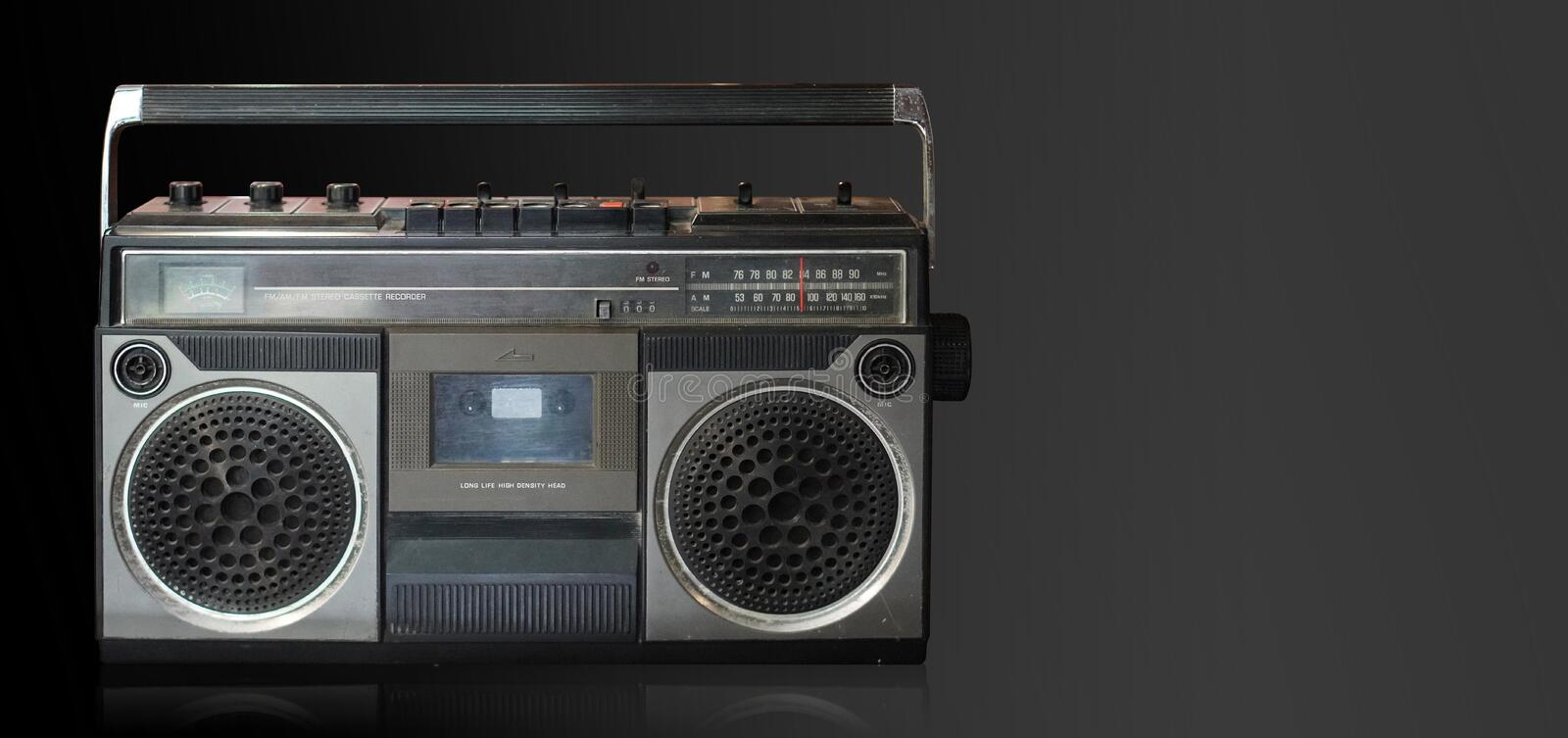 Front view antique black and gray radio on black and gray background,technology background,copy space stock images